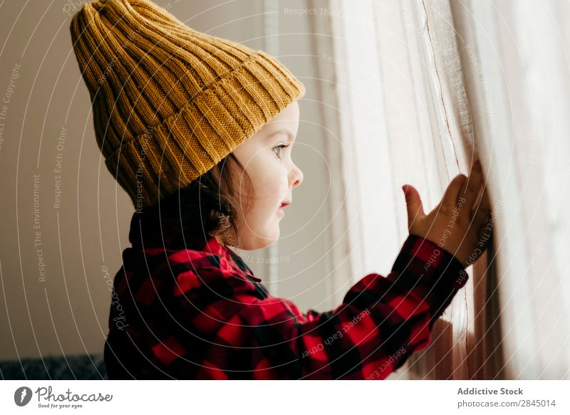 Cute boy posing in wool cap Boy (child) Excitement Hat Happy Child Youth (Young adults) Infancy Human being Easygoing Portrait photograph Expression Joy Small