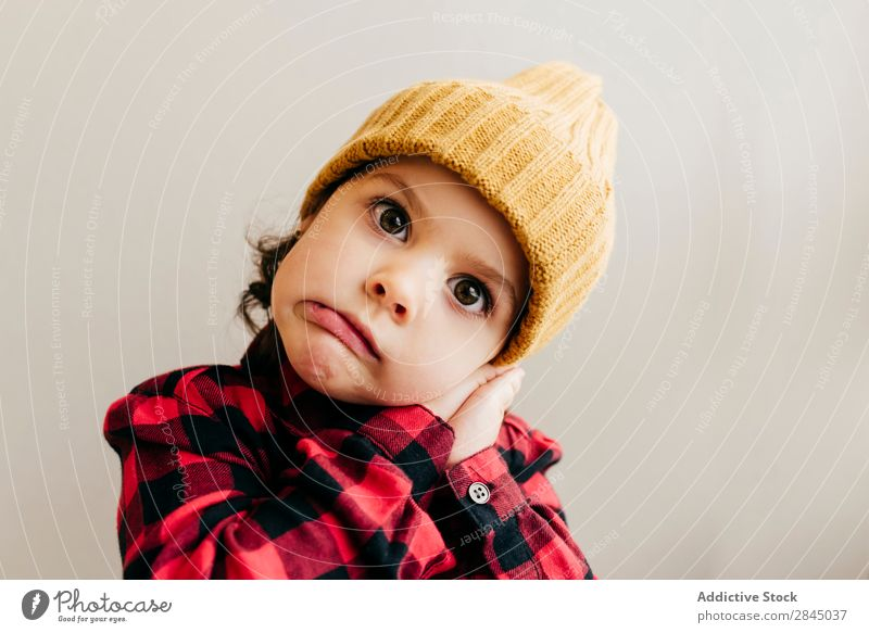 Cute boy grimacing Boy (child) making faces Hat Happy Child Youth (Young adults) Infancy Human being Easygoing Portrait photograph Expression Joy Small