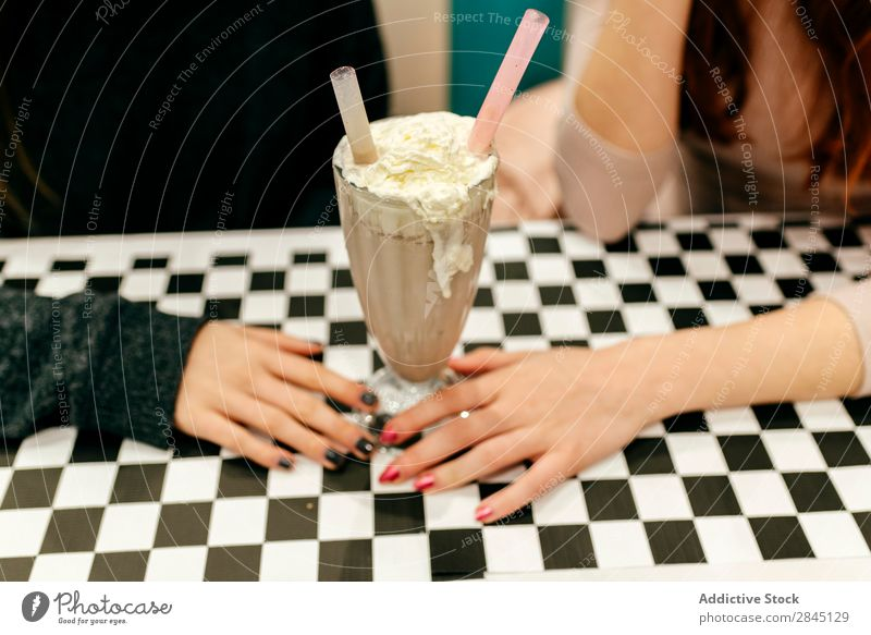 Unrecognizable women having cocktail Woman pretty Town Friendship Together Sit Drinking Milkshake Youth (Young adults) Beautiful Attractive Café Lady Fashion