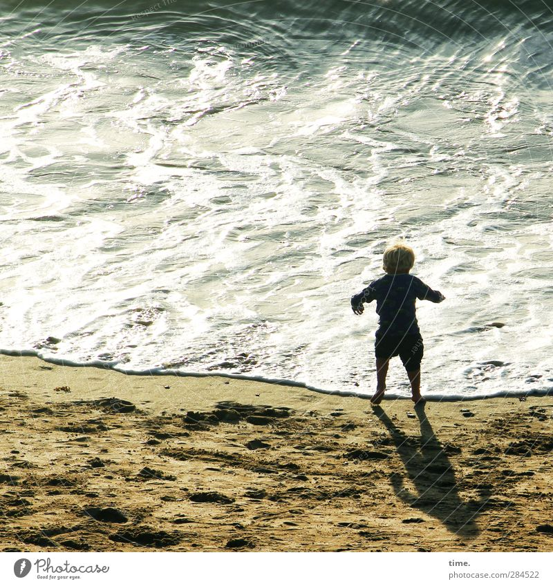 The exciting discovery of hydropower Child Infancy Life 1 Human being 3 - 8 years Sand Water Beautiful weather Waves Coast Beach Ocean English Channel Observe