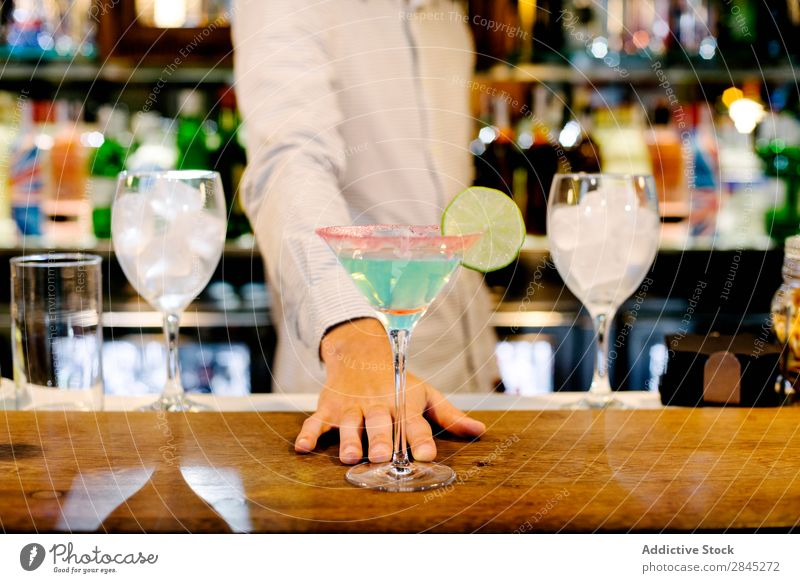 Hand of bartender with cocktail Man Bar Counter Glass Preparation Cocktail Party Alcoholic drinks Drinking Restaurant barman Night life Stir Pub Beverage