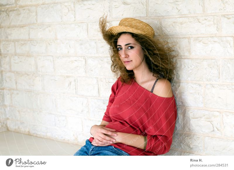 commemoration Young woman Youth (Young adults) 1 Human being Wind T-shirt Jeans Hat Hair and hairstyles Brunette Long-haired Curl Think Sit Beautiful Red White