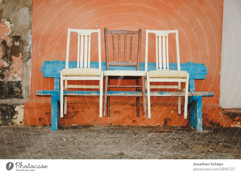Three chairs on a bench, Puerto de la Cruz, Tenerife Facade Blue Orange White Colour Bench Chair Row of seats Row of chairs 3 Wall (building) Spain Canaries