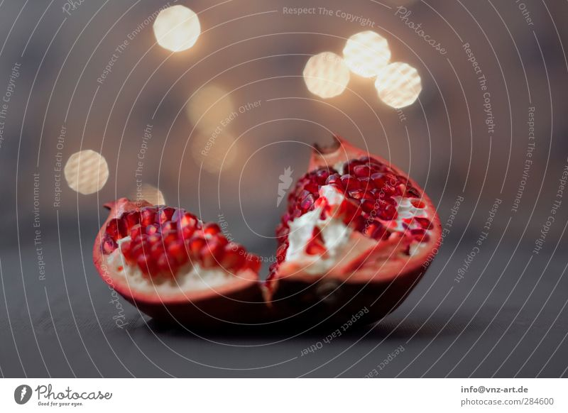 garnet Pomegranate Red Light Moody Warmth Shallow depth of field Fruit Lighting Lovely Crunchy Fresh Healthy Eating Blur Seed Individual Deserted Still Life