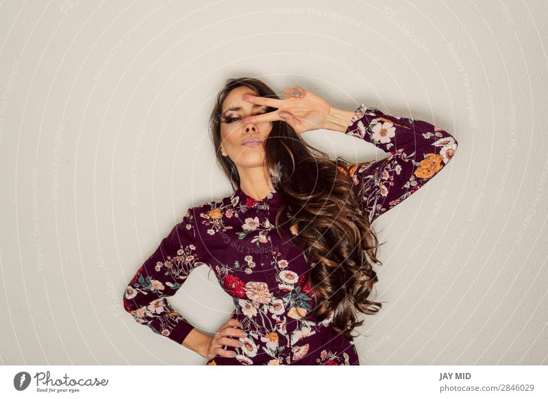 beautiful woman showing peace sign over eye with cool gesture Style Joy Happy Beautiful Contentment Success Human being Feminine Woman Adults Hand 1