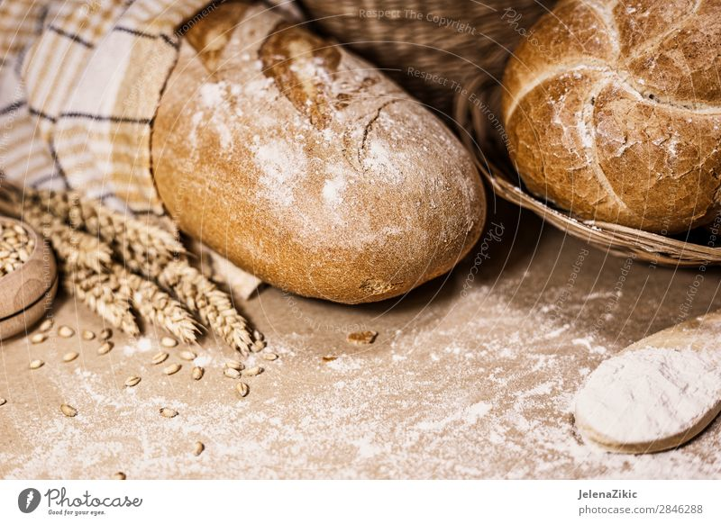 Freshly baked bread, wheat and flour on a rustic background Food Dough Baked goods Bread Nutrition Eating Breakfast Lunch Dinner Buffet Brunch Organic produce