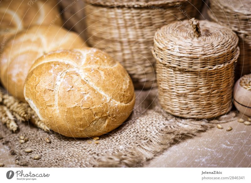 Fresh bread and wheat on a rustic background Food Dough Baked goods Bread Nutrition Eating Breakfast Lunch Dinner Buffet Brunch Organic produce Healthy Eating