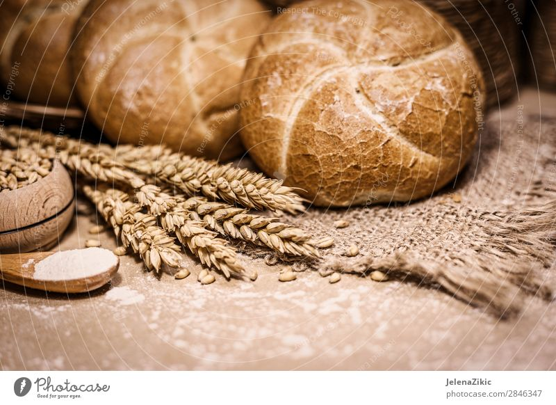 Freshly baked bread, wheat and flour on a rustic background Food Dough Baked goods Bread Nutrition Eating Breakfast Lunch Dinner Buffet Brunch Table Kitchen