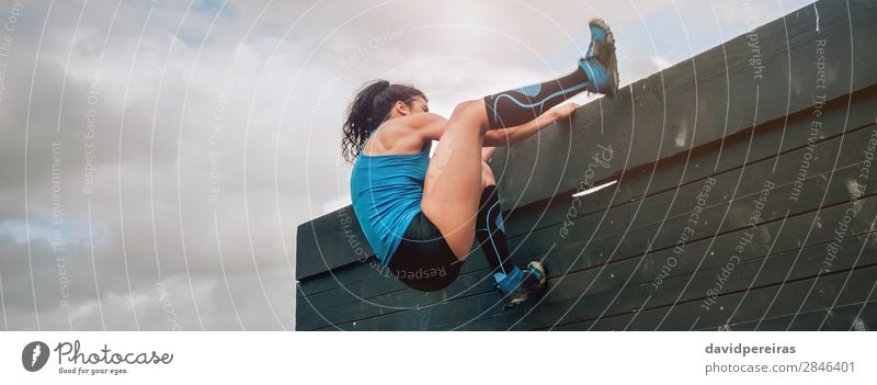 Participant in obstacle course climbing wall Lifestyle Sports Climbing Mountaineering Internet Human being Woman Adults Sneakers Strong Effort Energy