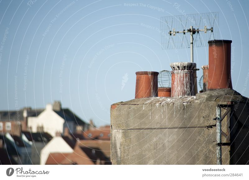Clay chimney pots House (Residential Structure) Antenna aerial Sky Architecture Roof Chimney Bird Blue Red Variety rooftop droppings vent poop roofscape