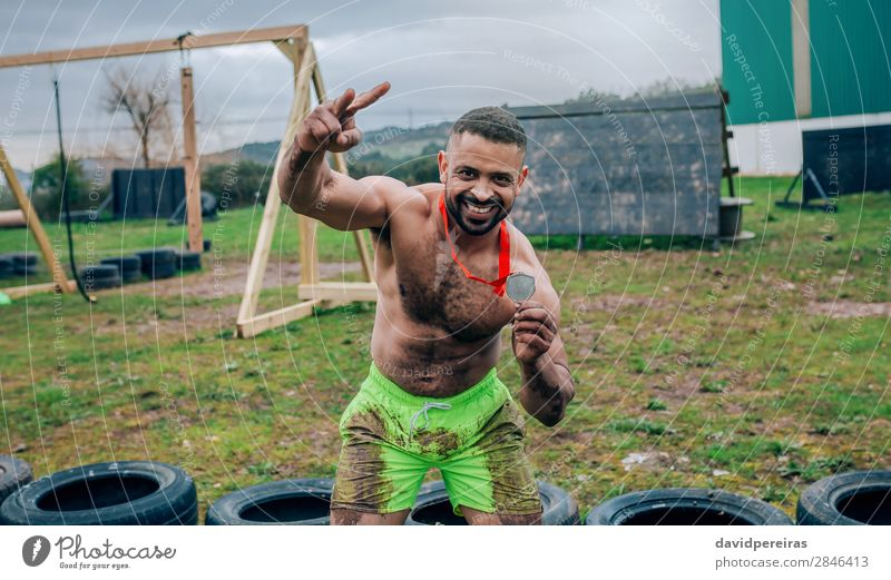 Athlete showing medal after race Happy Feasts & Celebrations Sports Award ceremony Success Human being Man Adults Hand Smiling Authentic Muscular Strong Black