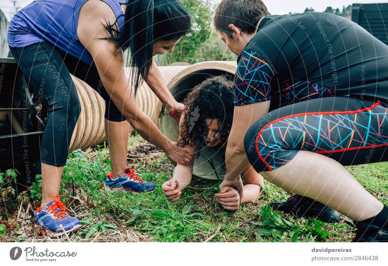 Participants obstacle course going through a pipe Lifestyle Joy Sports Human being Woman Adults Group Tube Authentic Strong Effort Competition Teamwork