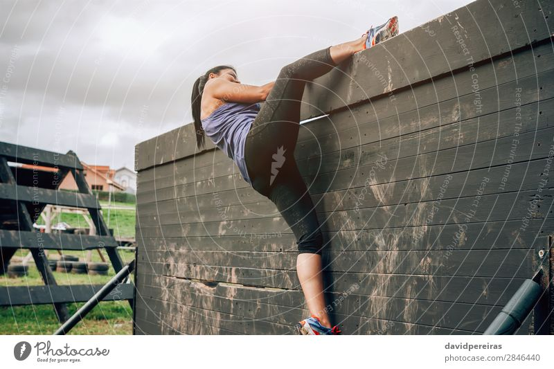 Participant in obstacle course climbing wall Lifestyle Sports Climbing Mountaineering Human being Woman Adults Sneakers Authentic Strong Loneliness Effort