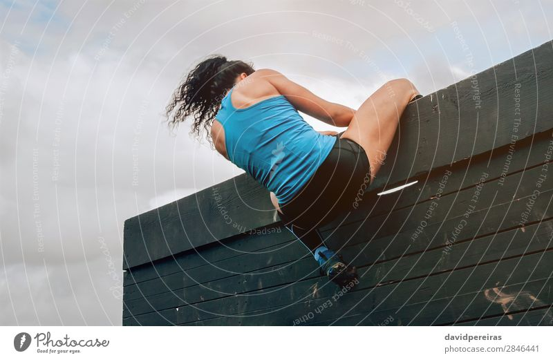 Participant in obstacle course climbing wall Lifestyle Sports Climbing Mountaineering Human being Woman Adults Sneakers Authentic Strong Effort Energy
