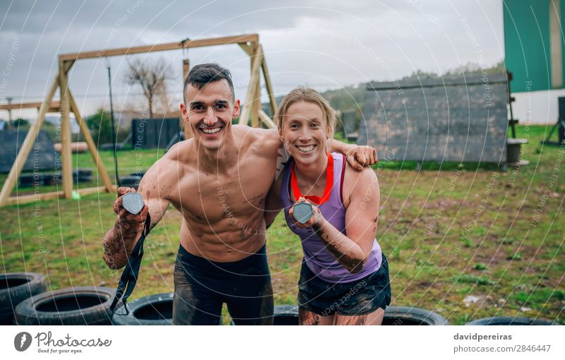 Athletes showing medals after race Happy Playing Feasts & Celebrations Sports Award ceremony Success Human being Woman Adults Man Couple Hand Smiling Authentic