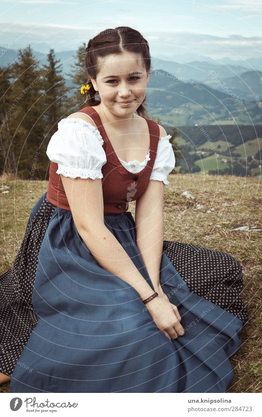 The innocence of the land Girl Young woman Youth (Young adults) 1 Human being 13 - 18 years Child Nature Landscape Meadow Alps Mountain Peak Dress