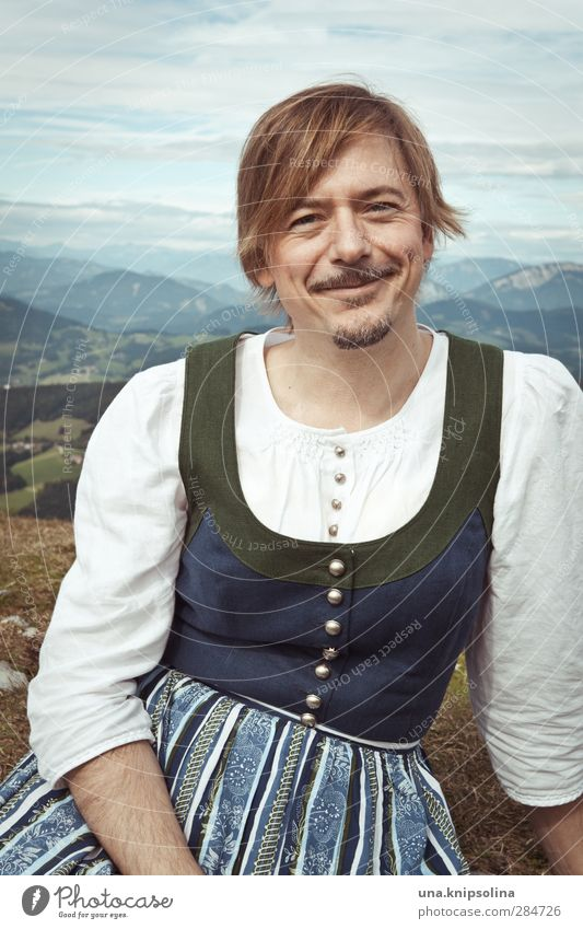 There's koa sin on that mountain pasture Man Adults 1 Human being 30 - 45 years Environment Nature Landscape Meadow Alps Mountain Peak Dress Traditional costume