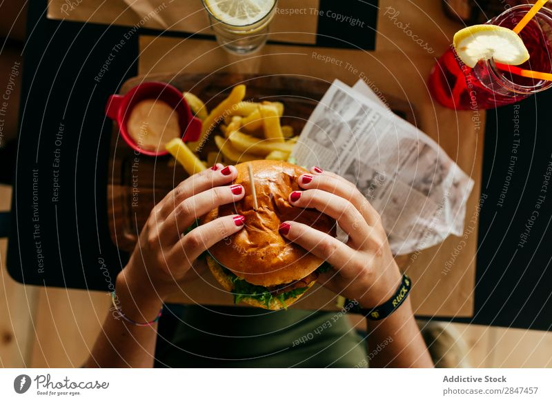 Crop woman picking a hamburger Fries Fast food Hamburger Food Fresh Meat Meal Unhealthy Snack Sandwich Speed Roll Tasty Lettuce Delicious Classic Gourmet Lunch