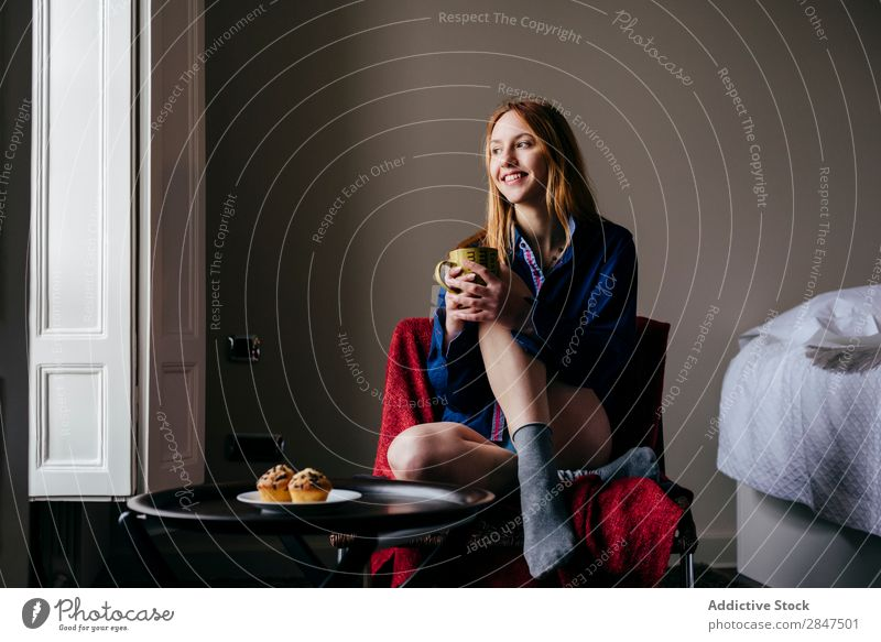 Pensive woman in armchair Woman Home Youth (Young adults) Beautiful Considerate Armchair pretty Beauty Photography Happy Human being Room Cute To enjoy