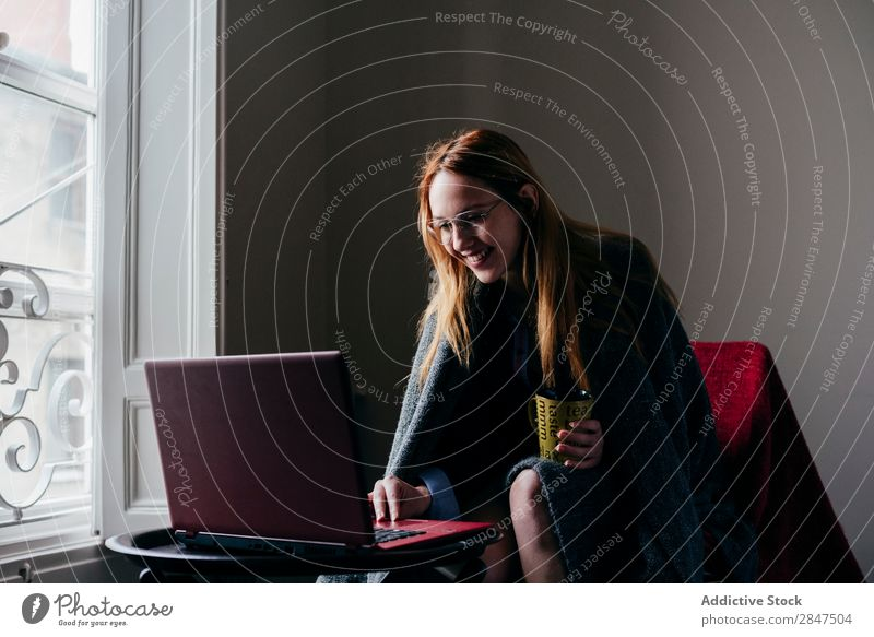 Woman in armchair using laptop and drinking coffee Home Youth (Young adults) Beautiful Considerate Pensive pretty Beauty Photography Happy Room Cute To enjoy