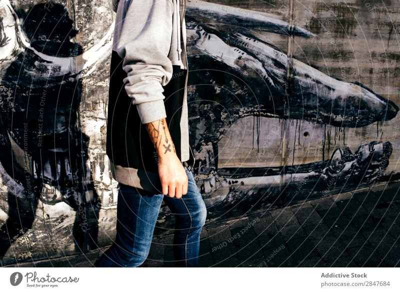 Crop tattooed man against wall with graffiti Man Town Graffiti Hipster millennial artistic Grunge Concrete Wall (building) Style City Self-confident Easygoing