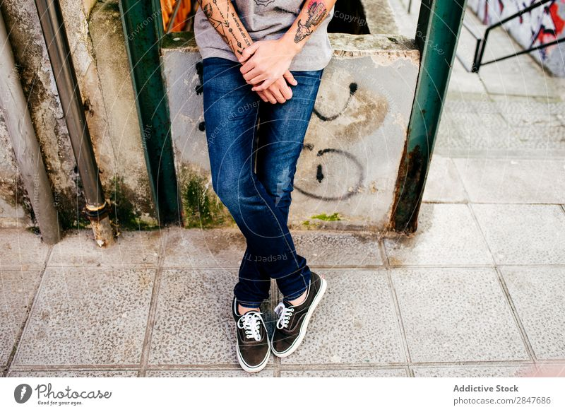 Crop hipster posing on street Man Town Hipster Posture Summer millennial Tattooed Self-confident Style City Youth (Young adults) Clothing Easygoing Street