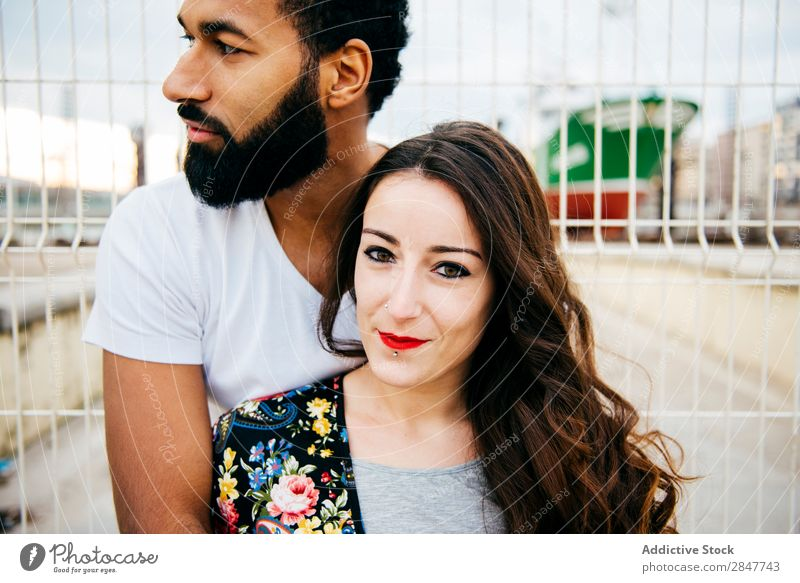 Beautiful multiracial couple Couple Town loving Embrace Relationship multiethnic embracing Affectionate Beauty Photography Exterior shot valentine Street Modern