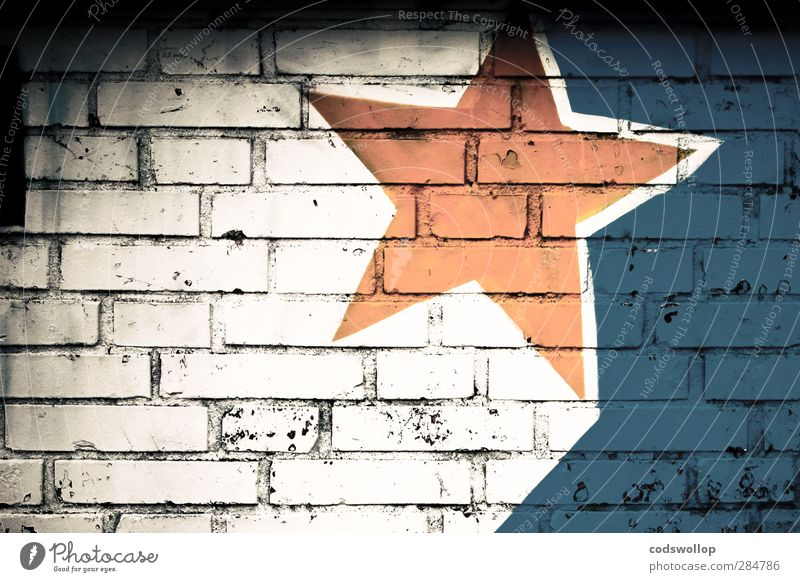 R136a1 Deserted Wall (barrier) Wall (building) Facade Sign Graffiti Blue Yellow White Star (Symbol) Graphic Colour photo Exterior shot Pattern