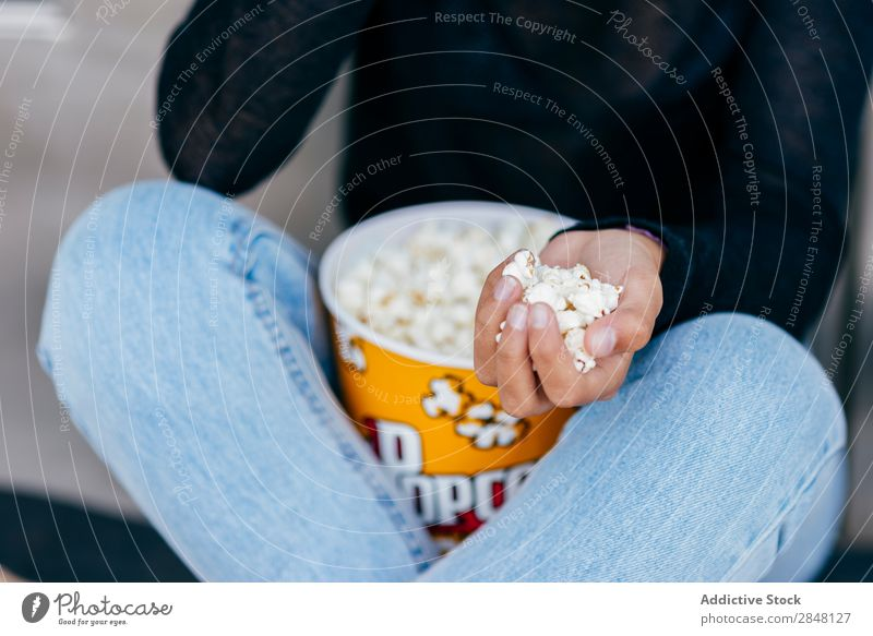 Crop girl with popcorn in hand Woman Popcorn Town Accumulation Youth (Young adults) Snack Style Hold Clothing Hipster Sit Bucket Culture Independence Posture