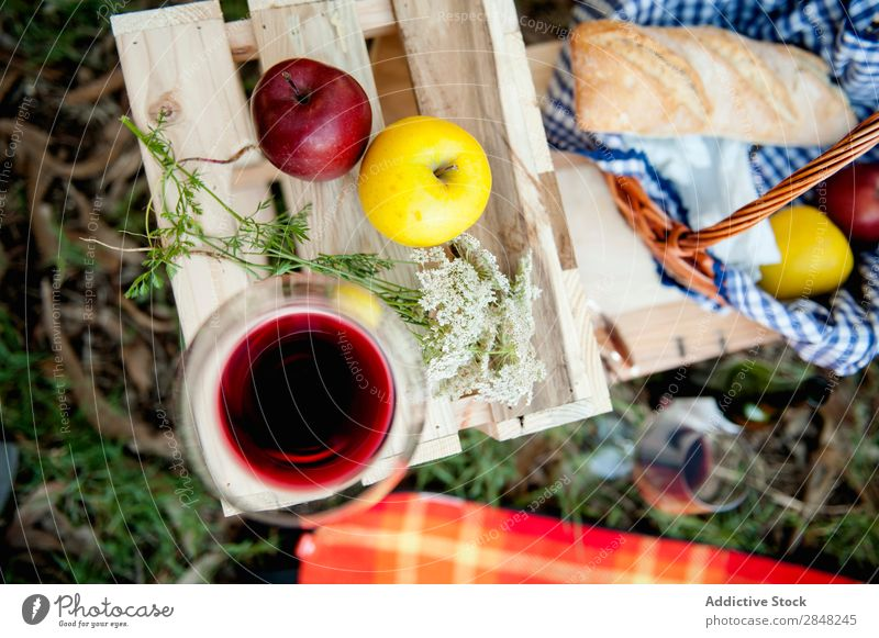 Wineglass and apples Wine glass Apple Picnic Food Flower Box Red Summer Basket Fruit Park Bread Meal Grass Glass Spring Lunch Leisure and hobbies romantic