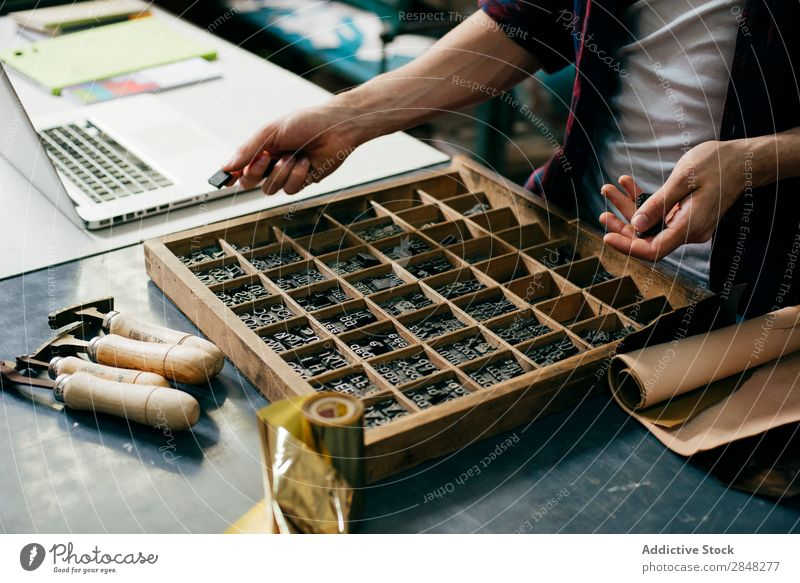 Crop worker choosing printing letters Craftsman Typography Letter (Mail) Stamp Workplace Collection Tradition workspace printout Technician Handcrafts