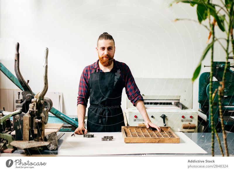 Bearded man working in printing company Man Typography workspace Posture printout bookmaking Technician Self-confident Handcrafts Letter (Mail) letterpress