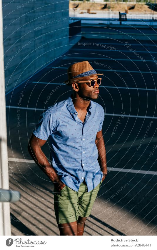Stylish black man posing at street Man Style Summer Posture Hip & trendy Black Town Hipster Street Shirt Clothing fashionable handsome Masculine Easygoing Hat