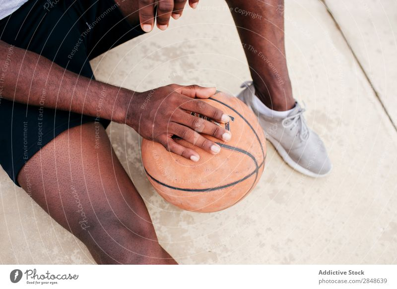 Crop man holding basketball Man Sports ground Basketball Posture African-American Player Vacation & Travel street ball Leisure and hobbies Skyline Town