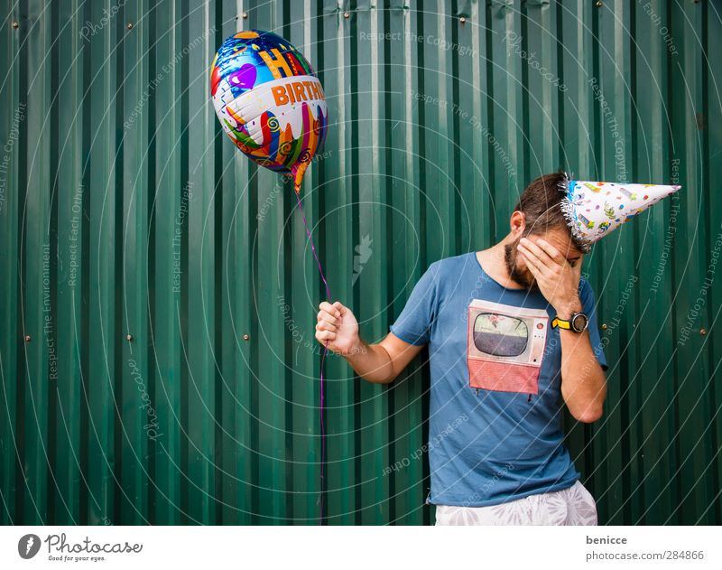 Getting older Birthday Human being Man Youth (Young adults) Young man Old Balloon party hat Wall (building) Cry Disappointment Sadness Tears To hold on Green