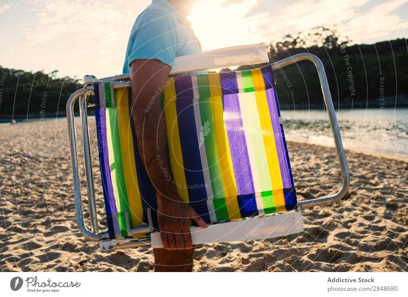 Man grabbing beach chair sunbed Vacation & Travel Nature Relaxation Lounge traveler Tropical Peaceful Leisure and hobbies Natural Summer Sunlight Sunbathing