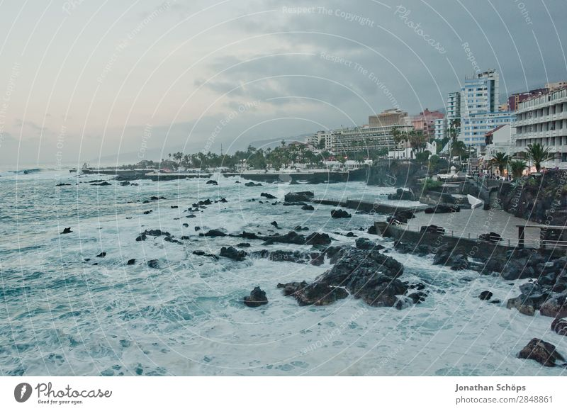 Coast in Puerto de la Cruz, Tenerife Nature Town Port City Esthetic Canaries Spain Atlantic Ocean Waves Beach Blue Twilight Skyline Rock Sea promenade Gale Wind
