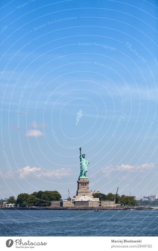 Statue of Liberty against the blue sky, New York. Vacation & Travel Tourism Freedom City trip Island Sky River Landmark Monument Historic Blue Inspiration Brave