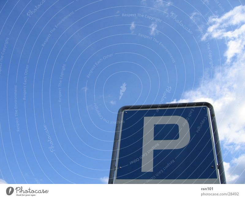 Parking Space? Parking lot Clouds Leisure and hobbies Signs and labeling Sky Blue
