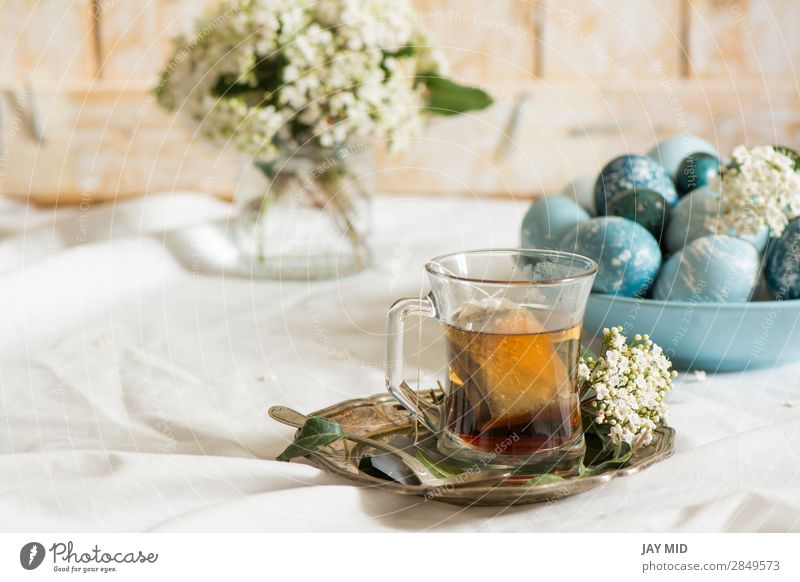 Naturally dyed Easter blue eggs, and tea cup, Food Breakfast Beverage Tea Plate Cup Mug Beautiful Decoration Feasts & Celebrations Flower Blue Green White