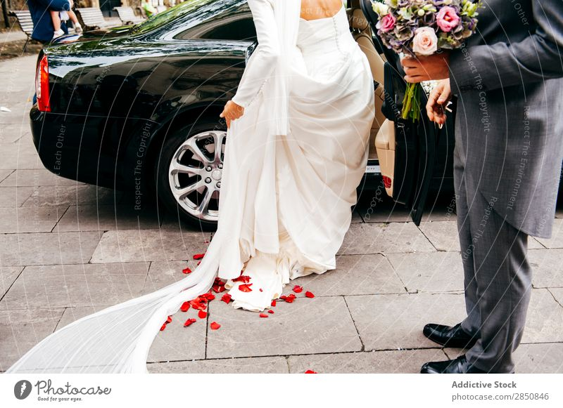 Bride getting into car Groom Car Wedding Love Couple Relationship Bouquet Flower Happiness romantic Suit bridal Married Feasts & Celebrations newlywed Style