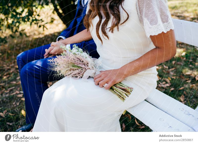 Crop bride and groom on bench Bride Groom Bench Couple Feasts & Celebrations Together Summer Flower