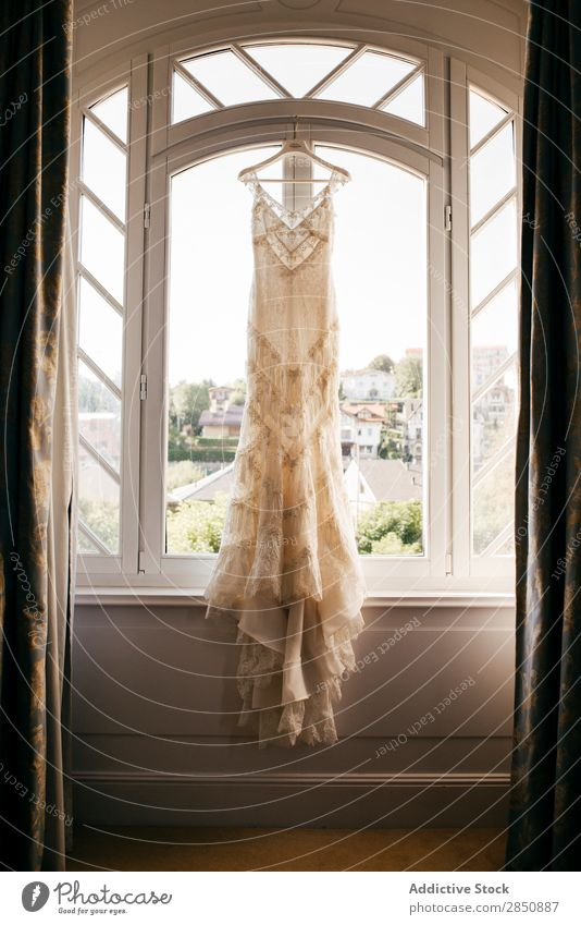 Wedding dress hanging on window Dress Hanger Elegant Ornamental Beauty Photography Clothing Light