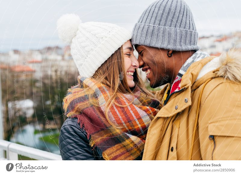 Couple posing on street Together City Town Harbour Port Scarf pulling Mixed race ethnicity multiethnic Black Love Woman Man Human being Lifestyle