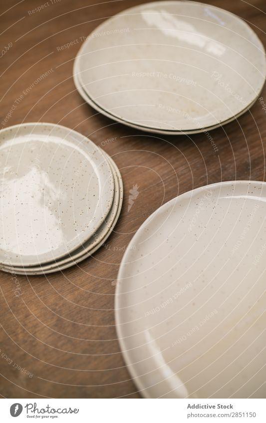 Rows of handicraft plates on table Crockery Handicraft Clay ceramic Craft (trade) dishware glazed Arrange clay ware Art Pottery Design Leisure and hobbies