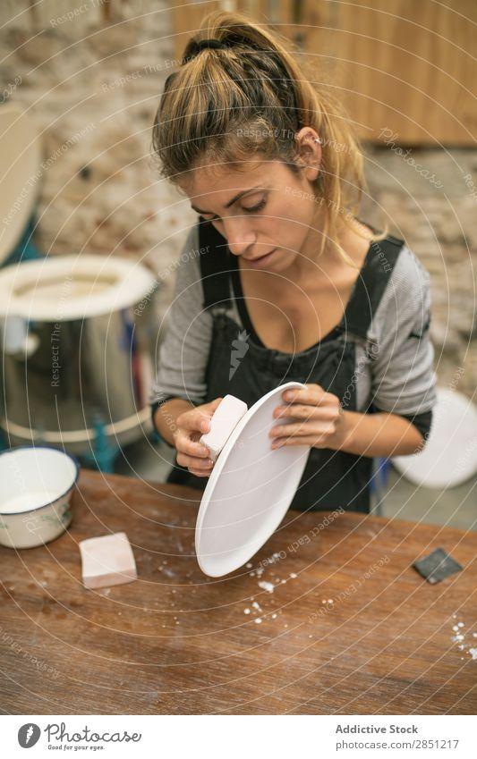 Woman working with clay plates Workshop Crockery handwork ceramics Professional Make craftsmanship Enamel Clay Handicraft clay ware Work and employment creating
