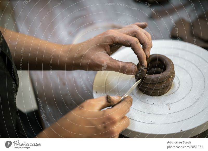Crop woman working with clay Woman Clay Workshop shaping instrument Craftsman handwork Wheel Artisan Employees & Colleagues Handcrafts ceramic Raw