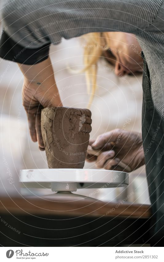 Woman working with clay making pot Workshop Pot shaping Artisan Earthenware Clay concentrated Handicraft Tradition occupation Master Work and employment