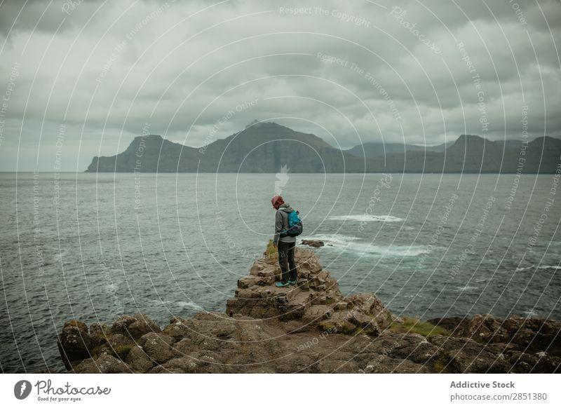 Traveler on rocks of ocean Human being Ocean Dream Freedom Cliff Coast Peaceful Backpacking