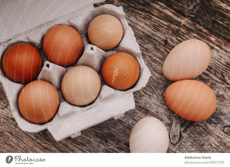 Eggs on a wooden table Wood Table Background picture Box lay Countries Village Flat Food Top Farm White Fresh Ingredients Easter Breakfast Chicken Healthy Brown